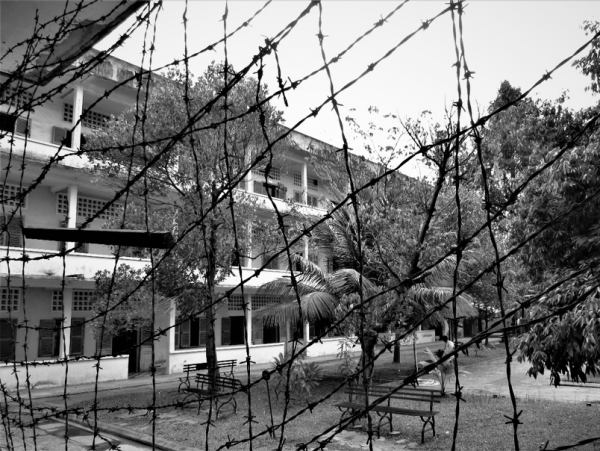 Visitors can step inside barbed wire covering the façade of a building at Tuol Sleng and look out. This creates an immediate sense of claustrophobia, simulating what the prisoners might have experienced here.