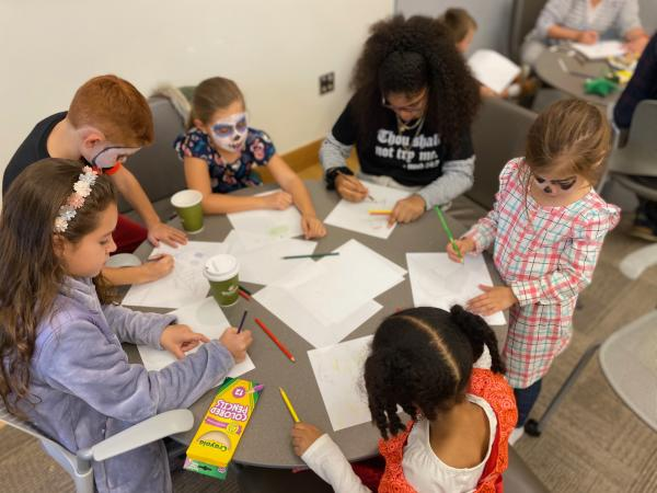 Photograph of children participating in a comics lesson