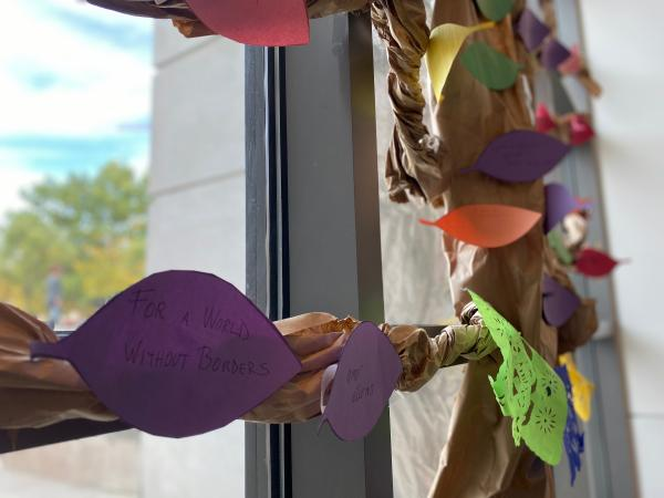 Photograph of wishing tree with handwritten wishes