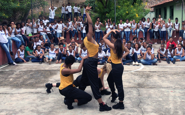 Student dancers in front of a crowd
