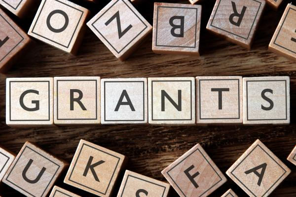 Scrabble tiles spelling out Grants